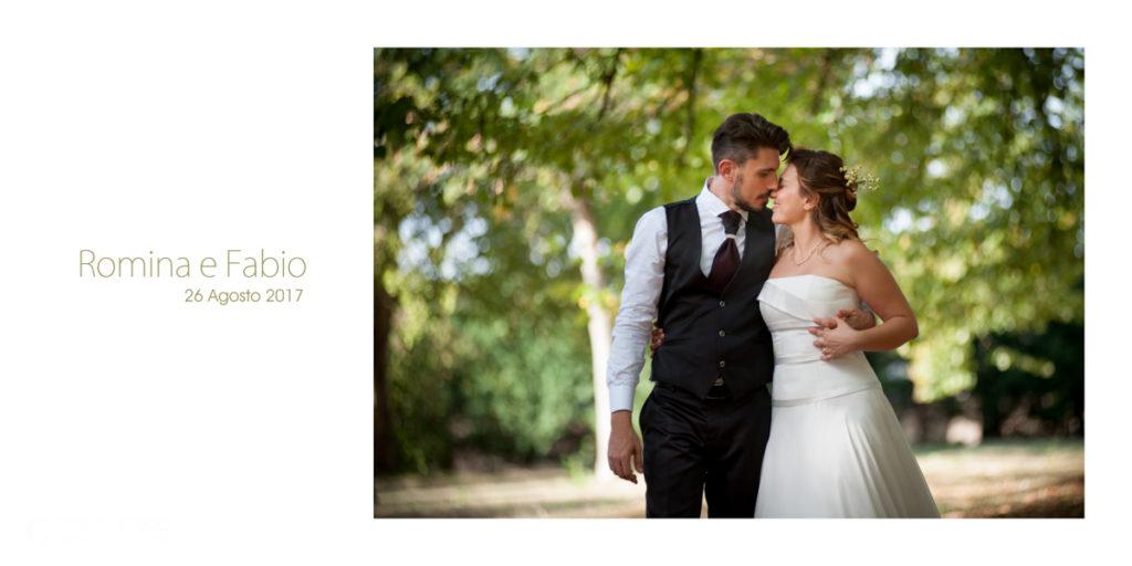 Romina e Fabio, una coppia felice e sorridente per un matrimonio romantico e divertente.